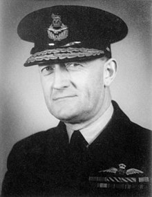 Head-and-shoulders portrait of man in dark uniform with ribbons and pilot's wings on chest, wearing peaked cap
