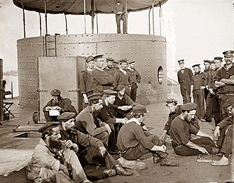 Part of the crew of USS Monitor, after her encounter with CSS Virginia (ex-USS Merrimack) USSMonitor1862.1.ws.jpg