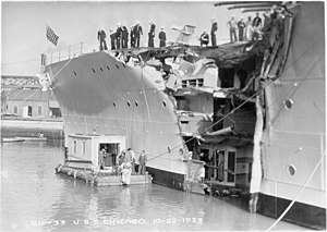 USS Chicago (CA-29) - The damaged USS Chicago (CA 29) with Mare Island's diving barge alongside at Mare Island Navy Yard on 25 Oct 1933 after her collision with the British freighter Silver Palm.