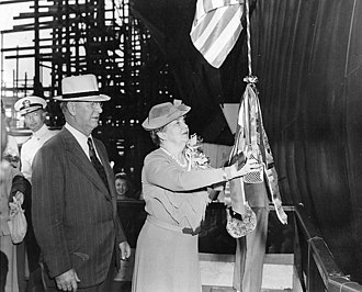 USS Hornet (CV-12) - Secretary of the Navy Frank Knox and his wife, Annie Reid Knox, sponsor of Hornet, christening the ship, 30 August 1943.