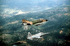 LTV A-7P Corsair II - A U.S. Air Force F-4D Phantom II flying in close formation with a Royal Norwegian Air Force F-5A aircraft during exercise Coronet Rawhide in 1982