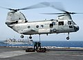 US Navy 020914-N-3986D-001 CH-46 delivers supplies to USS Washington.jpg