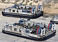 US Navy 030117-N-5067K-008 Landing Craft Air Cushion (LCAC) vehicles from Assault Craft Unit FIVE (ACU-5), loaded with elements of the 1st and 3rd Light Armored Reconnaissance (LAR) units.jpg