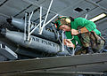 US Navy 030312-N-4965F-501 Aviation Structural Mechanic 2nd Class Kenn Walls from Rockford, Ill., performs maintenance on the wing of an S-3 Viking.jpg