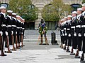 US Navy 031111-N-0615K-014 Sailors assigned to the U.S. Navys Ceremonial Guard stand in formation in front of the statue of the Lone Sailor during wreath laying ceremonies at the U.S. Navy Memorial.jpg