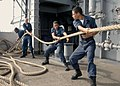 US Navy 031111-N-4190W-001 Four line handlers heave in one of the mooring lines.jpg