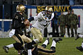 US Navy 031206-N-2383B-047 Navy linebacker Jeremy Chase is within reach of sacking Army quarterback Zac Dahman whos drawing back for a play action pass during one of the most revered rivalries in all of sports.jpg