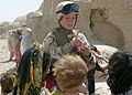 US Navy 040422-M-8096M-034 U.S. Navy Hospitalman 3rd Class Lori Butierries tells Afghan children to wait their turn for a piece of candy during a Coalition medical-dental civil affairs project in the village of Najoy, Afghanist.jpg