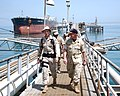 US Navy 040611-N-0402E-004 Chief of Naval Personnel, Vice Adm. Gerry Hoewing, speaks with Sailors assigned to Mobile Security Force Detachment Two One aboard the Al Basrah Oil Terminal.jpg