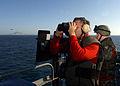 US Navy 040710-N-4953E-013 Gunner's Mate 2nd Class Charles Capps looks for ship contacts as Machinist's Mate 2nd Class Walter Blackburn mans a .50 caliber gun mount as USS Harry S. Truman (CVN 75) transits the Strait of Gibralt.jpg