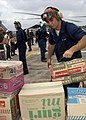 US Navy 050104-N-9403F-121 A Sailor assigned to Carrier Air Wing Two (CVW-2) stacks boxes of relief supplies at the Bande Aceh Airport, Sumatra, Indonesia.jpg