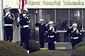 US Navy 050107-N-9851B-007 Dental Technician 3rd Class Adam Garcia attaches the National Flag of Japan as Hospital Corpsman Seaman Apprentice Lavonda Gordon attaches the U.S. National Ensign to lanyards during a special colors.jpg