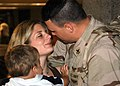 US Navy 050915-N-3019M-002 Master-at-Arms 1st Class Joshua Johnson, assigned to Naval Station Pearl Harbor Security, greets his wife and son after returning from an eight-month deployment.jpg