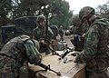 US Navy 061206-N-3560G-009 Members of Naval Mobile Construction Battalion Four (NMCB-4) fieldstrip and clean their M16-A service rifle during field exercise Operation Bearing Duel.jpg