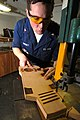 US Navy 070131-N-2659P-168 Hull Technician 3rd Class Greg Swinney uses a band saw to cut out a wooden aircraft carrier shaped ceremonial coin board in the carpentry shop aboard Nimitz-class aircraft carrier USS John C. Stennis.jpg