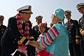 US Navy 070322-N-3659B-059 Commander, Carrier Strike Group (CCSG) 7, Rear Adm. Charles Martoglio, thanks a local child after receiving a lei from a local area child during a port visit to Busan, Republic of Korea.jpg