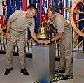US Navy 070802-N-7948R-002 Commander, Navy Recruiting Command (CNRC) Operations Director, Capt. Ray Wynne, and National Director of Enlisted Accessions, Cmdr. Glen Kaemmerer, (right) ring the bell on CNRC's quarterdeck si.jpg