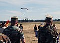 US Navy 070815-N-9860Y-038 A member of Explosive Ordnance Disposal Mobile Unit (EODMU) 11 completes a parachute landing to honor fallen comrades in Outlying Field.jpg