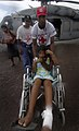 US Navy 070907-N-1810F-026 A girl injured during Hurricane Felix is moved by Nicaraguan Red Cross volunteers from an amphibious assault ship USS Wasp (LHD 1) helicopter, to a local hospital.jpg