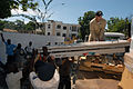 US Navy 070907-N-8704K-077 Senior Chief Operations Specialist Eugene Demers, attached to Military Sealift Command hospital ship USNS Comfort (T-AH 20), joins local policemen in offloading a medical bed donated by Project Handcl.jpg