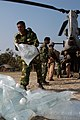 US Navy 071127-N-7955L-063 Marines with the 22nd Marine Expeditionary Unit (Special Operations Capable) and Bangladesh Army Soldiers offload bags of fresh water from a CH-46.jpg