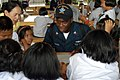 US Navy 080616-N-3581D-241 Yeoman 1st Class Andre L. Coffee, assigned to the frigate USS Jarrett (FFG 33) gets acquainted with students from Ban Kao Chan Primary School.jpg
