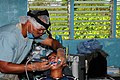 US Navy 081111-N-3173B-008 Staff Sgt. Julio Arriola provides dental care to a Guyanese child.jpg