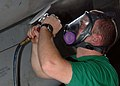 US Navy 081128-N-8822R-071 Aviation Structural Mechanic 3rd Class James Rhea performs corrosion prevention on an EA-6B Prowler, assigned to the.jpg
