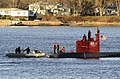 US Navy 081202-N-8467N-003 Crew members assigned to the Military Sealift Command rescue and salvage ship USNS Grasp (T-ARS 51) hook a towing line to submarine NR-1 as the boat makes its way along the Thames River.jpg