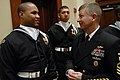 US Navy 090123-N-9818V-338 Master Chief Petty Officer of the Navy (MCPON) Rick West speaks with Airman Mervin Laravasquez, assigned to the U.S. Navy Ceremonial Guard.jpg