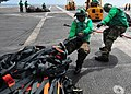 US Navy 090718-N-6233H-018 Sailors assigned to the Supply department of the aircraft carrier USS George Washington (CVN 73) hook cargo nets together for transport back to the dry cargo-ammunition ship USNS Alan Shepard (T-AKE 3.jpg