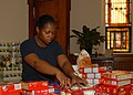 US Navy 091116-N-4938S-014 Operations Specialist 2nd Class Tia L. Myers, assigned to the Nimitz-class aircraft carrier USS George H.W. Bush (CVN 77), sorts food into categories for distribution at the St. Vincent De Paul Cathol.jpg
