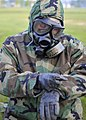 US Navy 100806-N-4440L-051 Equipment Operator Construction Apprentice Steven Lott dons his chemical, biological, radiological (CBR) gear during a mission oriented protective posture (MOPP) level 4 drill.jpg