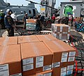 US Navy 100815-N-9706M-152 Personnel assigned to the amphibious transport dock ship USS Dubuque (LPD 8) Combat Cargo Platoon wrap a pallet of humanitarian supplies.jpg