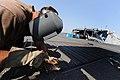US Navy 110202-N-7589W-163 Builder 2nd Class Joshua Helton welds a fence in front of High Speed Vessel Swift (HSV 2).jpg