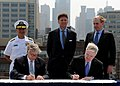 US Navy 110526-N-3237D-022 Secretary of the Navy (SECNAV) the Honorable Ray Mabus, right, and Lee Bollinger sign a treaty reestablishing the Naval.jpg