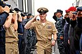 US Navy 110916-N-ZF681-487 Sailors aboard USS Halsey (DDG 97) render a salute to Chief Electronics Technician Anthony Andersen as he departs the sh.jpg