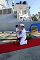 US Navy 111114-N-XD424-167 A Sailor assigned to the guided-missile destroyer USS Hopper (DDG-70) greets his son for the first time since being unde.jpg