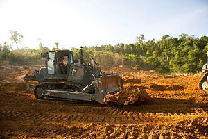 US Navy 111212-M-IS773-039 Heavy equipment operators with the 11th Marine Expeditionary Unit's (11th MEU) logistics combat element move rocks and d.jpg