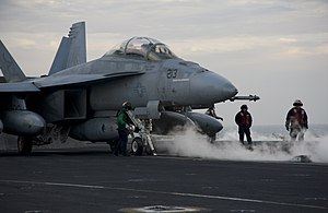 US Navy 120213-N-JN664-180 Sailors assigned to the Kestrels of Strike Fighter Squadron (VFA) 137 prepare an F-A-18E Super Hornet for launch on the.jpg