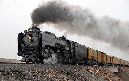 A Union Pacific train, pulled by one of the last steam locomotives. The UP was the first completed trans-continental railroad; a product of the Whig-component of the then-new Republican Party. It doesn't do this sort of thing anymore.