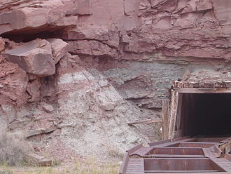Redox - Mi Vida uranium mine, near Moab, Utah. The alternating red and white/green bands of sandstone correspond to oxidized and reduced conditions in groundwater redox chemistry.