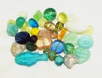 Uranium glass - Image: Uranium glass beads, white background