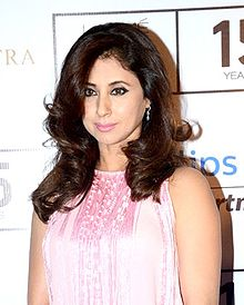 A picture of Urmila Matondkar looking away from the camera