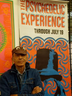 Victor Moscoso - Victor Moscoso in front of some of his work