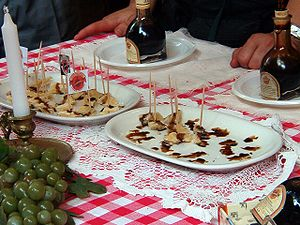 English: Balsamic vinegar drizzled over chunks...