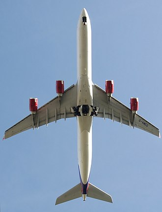 Airbus A340 - A Virgin Atlantic A340-600 with the undercarriage retracting