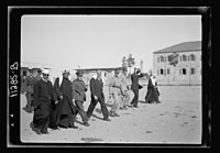Visit to Beersheba Agricultural Station (Experimental) by Brig. Gen. Allen & staff & talks to Bedouin sheiks of district by station superintendent. Mixed group in field of grain listening to LOC matpc.20535.jpg