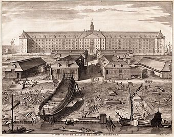 The shipyard of the Dutch East India Company (VOC) in Amsterdam (1726 engraving by Joseph Mulder). The shipbuilding district of Zaan, near Amsterdam, became one of the world's earliest known industrialized areas, with around 900 wind-powered sawmills at the end of the 17th century. By the early seventeenth century Dutch shipyards were producing a large number of ships to a standard design, allowing extensive division of labour, a specialization which further reduced unit costs. Voc.jpg