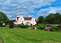 Wanås Castle with garden during a sunny summer day.jpg